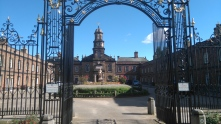 The ornately gated almshouses are still used today.